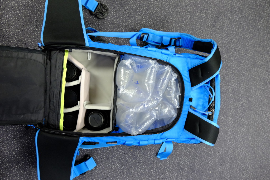 The pack with the back panel open. Inside is the small shallow ICU. Above the ICU is space for other essentials